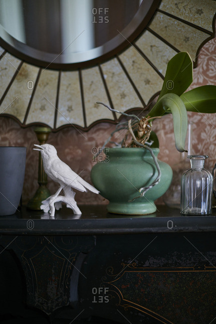 Plant and figurine on mantle