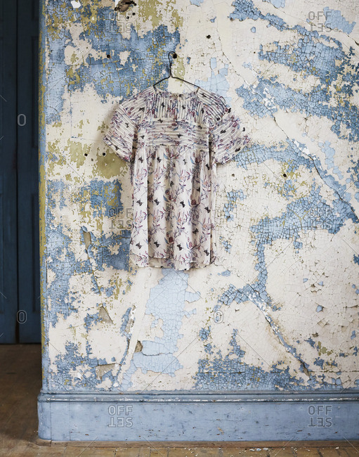 Blouse hanging on wall - Offset