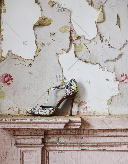 High heel on a mantle