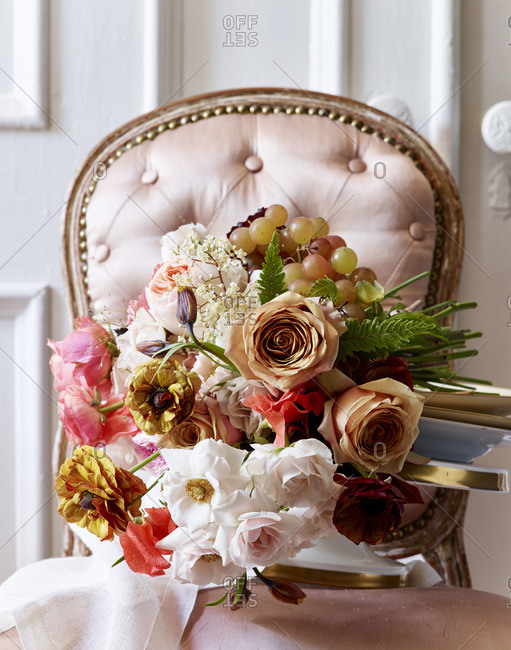Floral bouquet on pink chair