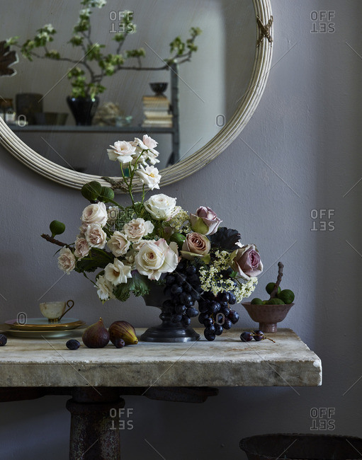 Floral centerpiece with fruit