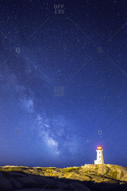 Peggy's Cove Lighthouse at night with the Milky Way in the night sky