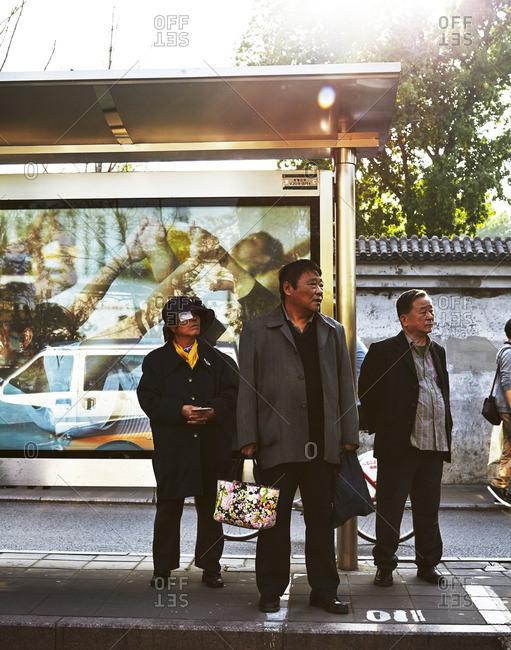 People at Beijing bus stop