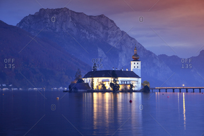 Ort Castle on Lake Traunsee and Traunstein Mountain at dusk