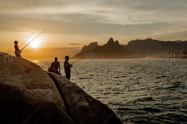 Sunset view of fishermen on Ipanema Beach from Arpoador with Morro Dos Hermanos in the background