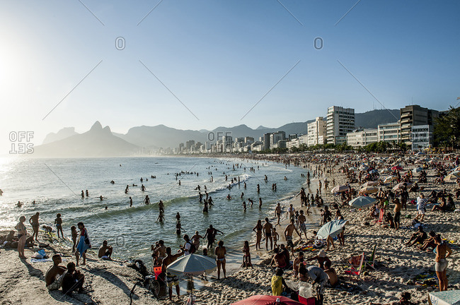 Sunset in Ipanema Beach from Arpoador with Morro Dos Hermanos in background