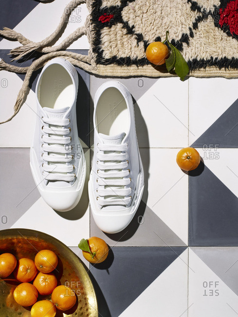 Pair of white shoes on floor