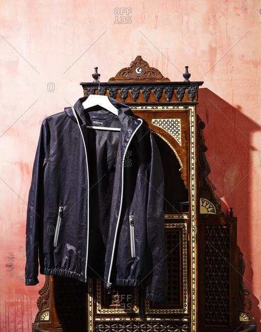 Designer jacket hanging from furniture