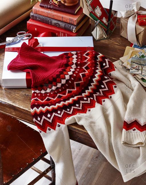 Turtleneck sweater on table