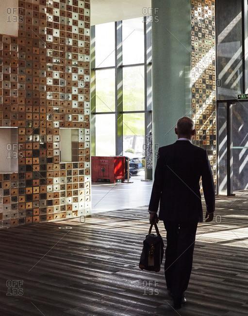 Man in modern Beijing hotel