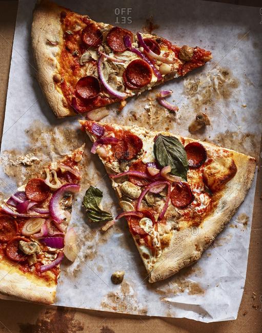 Slices of pizza in box