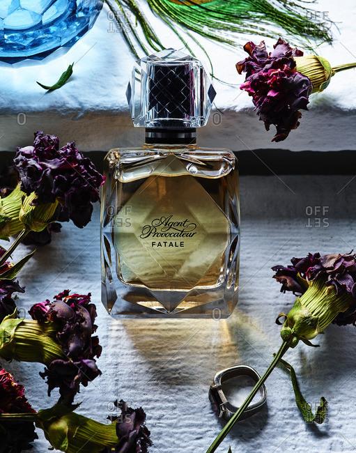 Bottle of perfume in sunlight