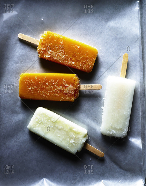 Four popsicles on wax paper