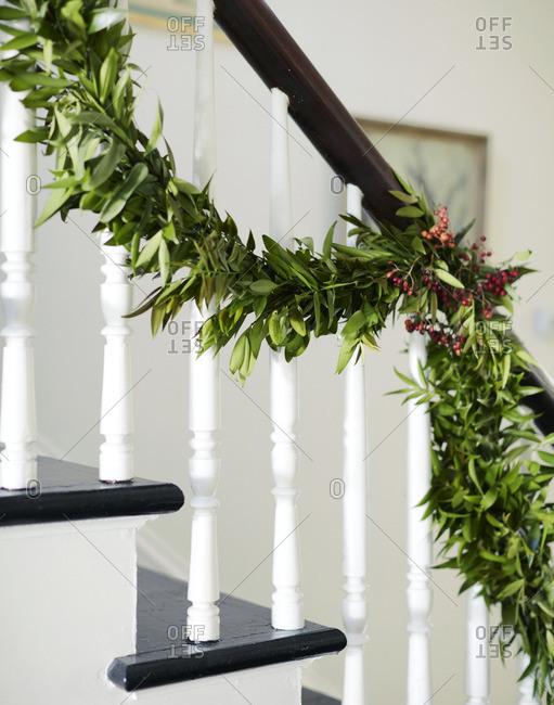 Pine garland on stair railing