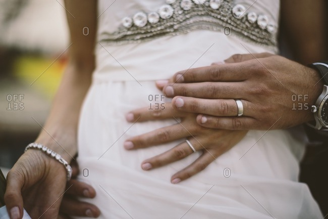 Wedding rings on a bride and groom's hands