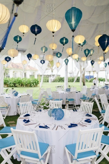 A tent decorated for a wedding reception at a beachside luxury resort in Southeast Asia