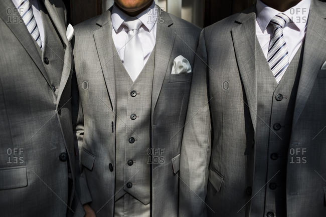 Close-up of a groom surrounded by his groomsmen