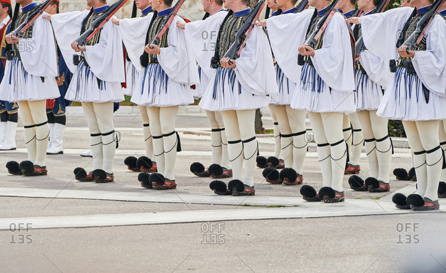 Details of the traditional clothes of Evzones soldiers during the changing of the honor guards ceremony in front of  the Tomb of the Unknown Soldier at the Parliament Building in Syntagma Square, Athens, Greece.