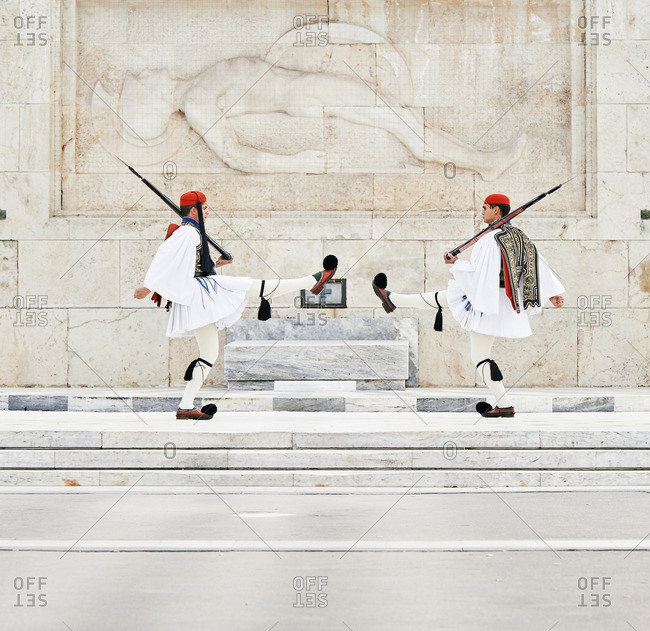 Athens, Greece - March 27, 2016: Perfect the coordination of movements during the changing of the honor Evzones guards ceremony in front of  the Tomb of the Unknown Soldier at the Parliament Building in Syntagma Square, Athens, Greece.