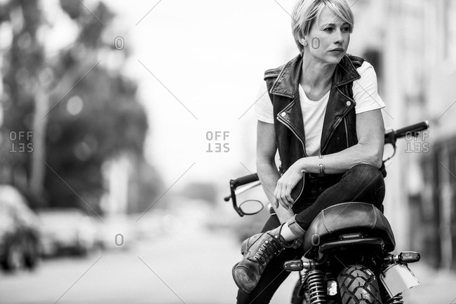 Woman sitting on a motorcycle on the street