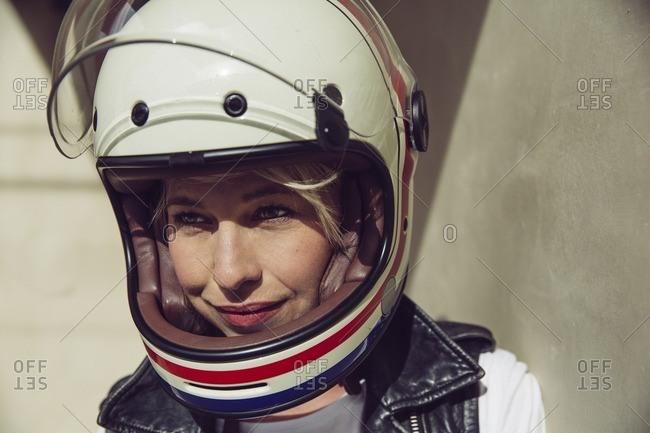 Woman wearing a motorcycle helmet