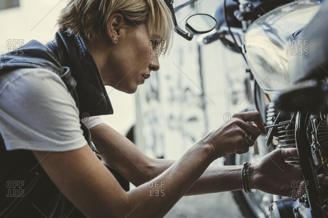 Woman working on a motorcycle