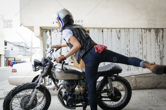Woman preparing to ride a motorcycle