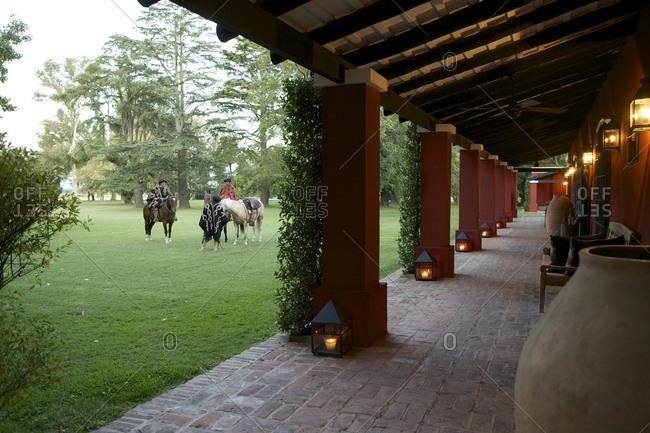 March 18, 2013: Gauchos with horses at luxury estancia in San Antonio de Areco, Argentina