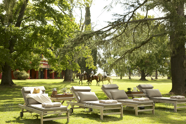 Chaise lounges on lawn at upscale ranch in Argentina