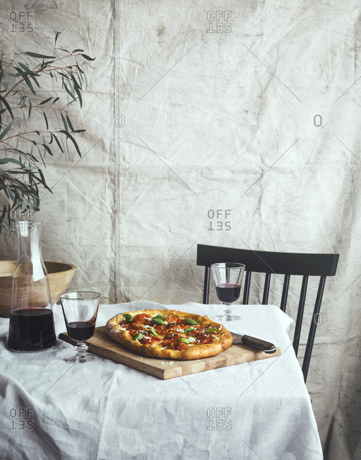 Table for two with homemade pizza and red wine