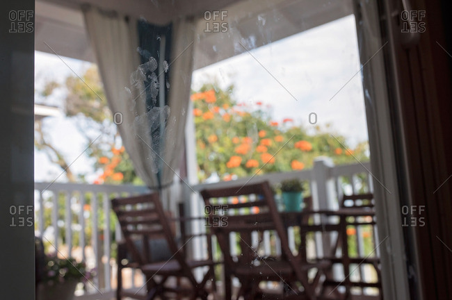 Kid's handprint on glass door leading outside to the patio