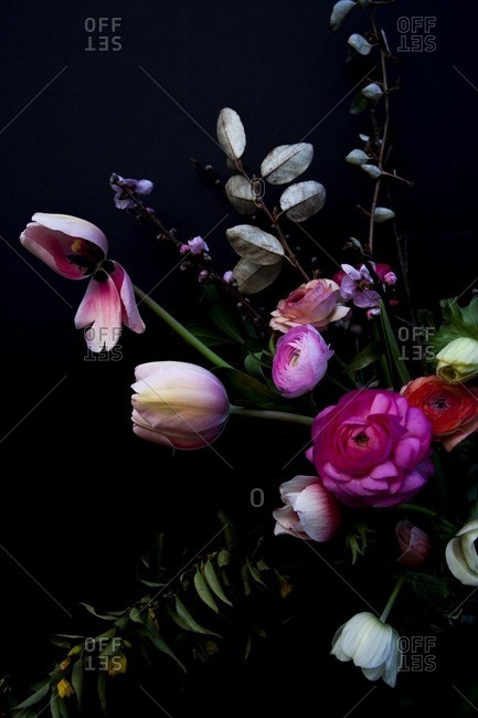 Bouquet of colorful flowers on a black seamless background