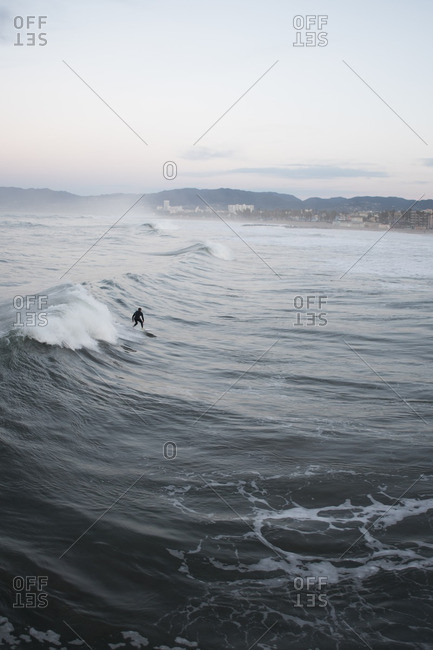 Surfer riding waves off of Venice Beach