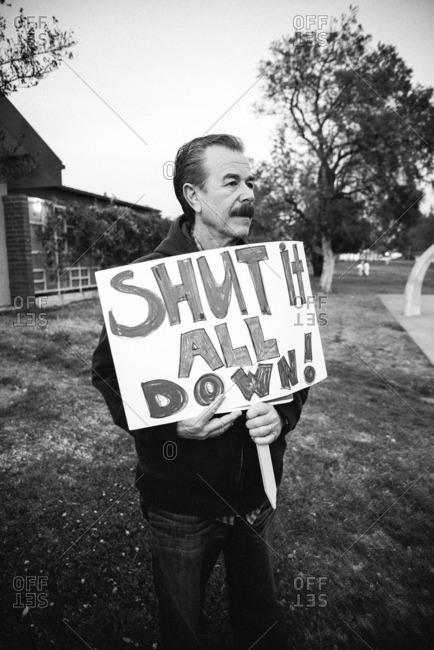 Los Angeles, CA, USA - February 26, 2016: Man holding sign in protest