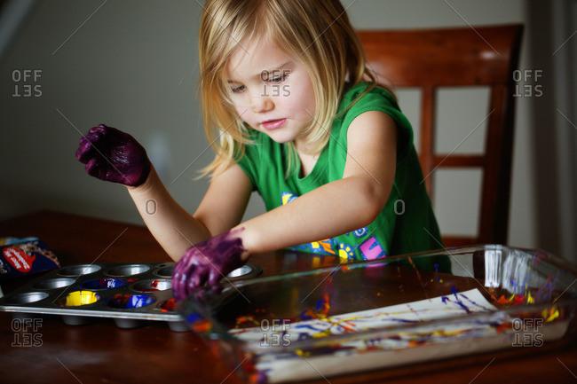 Little girl finger painting