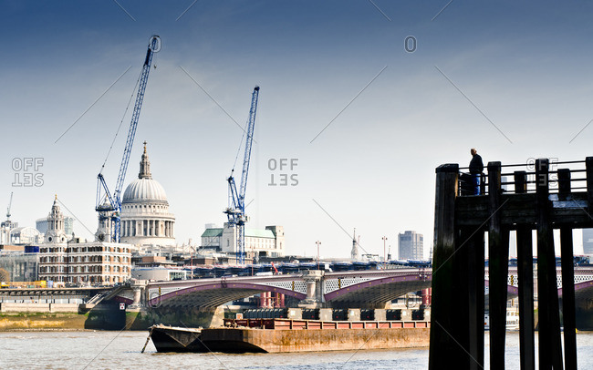London, England - March 28, 2012: Barge on Thames in London