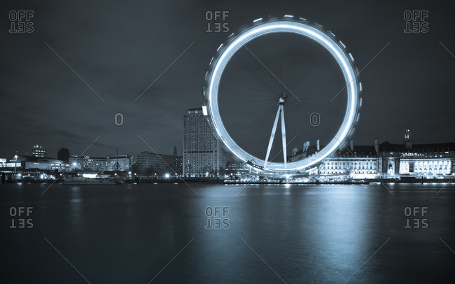 London, England - March 31, 2012: London Eye at night