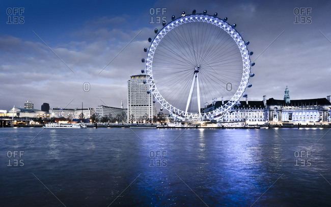 London, England - March 31, 2012: London Eye on the Thames river