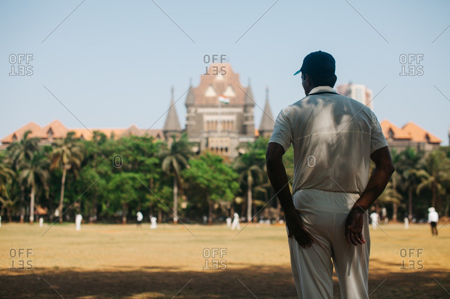 Man watching cricket match, Mumbai