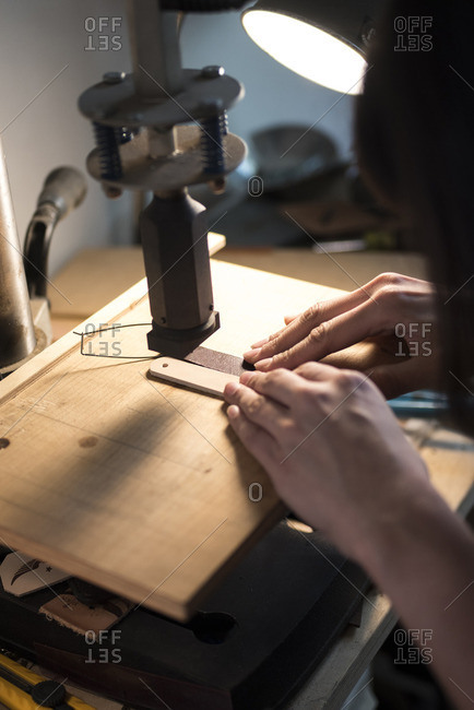 Craftsperson creating leatherwear
