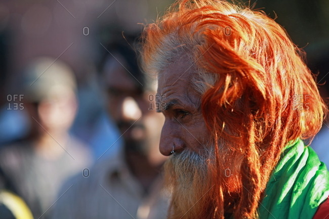 Pakistan - March 31, 2014: Elderly man with long henna-dyed hair
