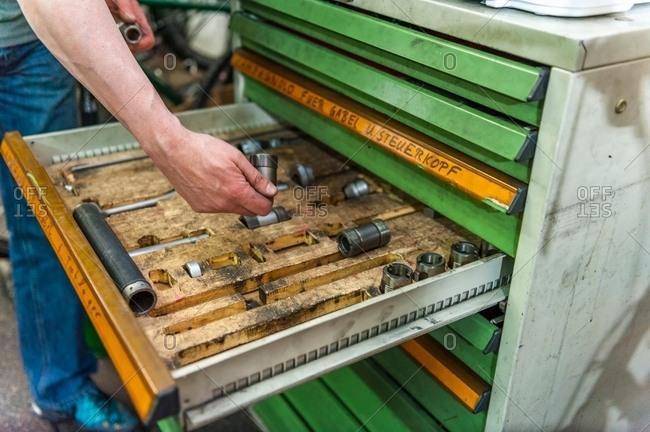 Mechanic placing tool into drawer