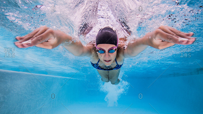 Underwater view of teenage girl swimming in pool