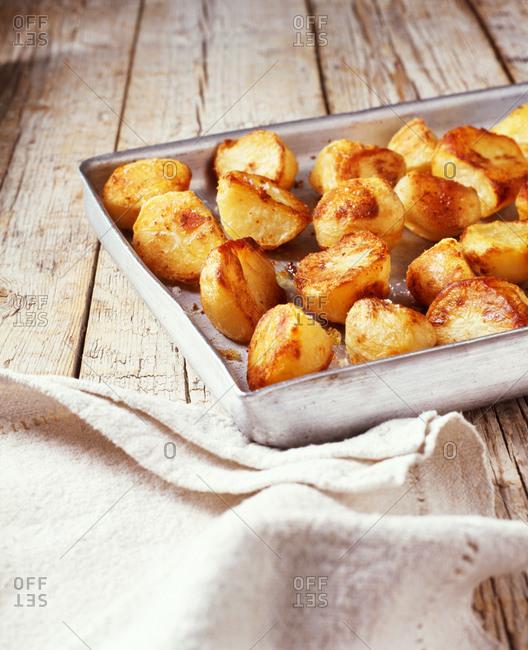 Roasted potatoes in roasting tin