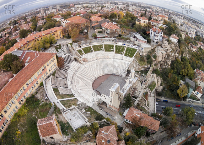 Roman amphitheater surrounded by the city in Plovdiv, Bulgaria