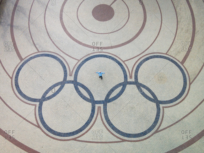 Chepelare, BULGARIA - November 13, 2015: Man standing in the middle of Olympic rings in a square