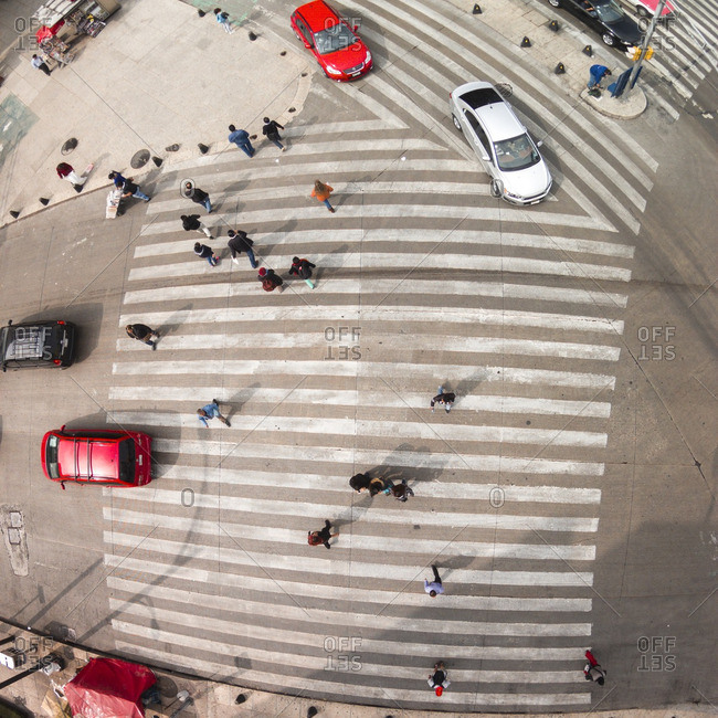 Cars and pedestrians at a busy crosswalk in Mexico City