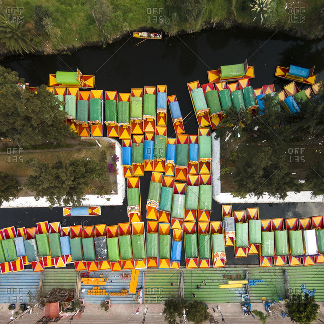 Colorful trajineras boats floating in a canal in Xochimilco, Mexico City