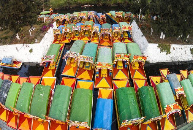 Colorful trajineras boats in a canal in Xochimilco, Mexico City