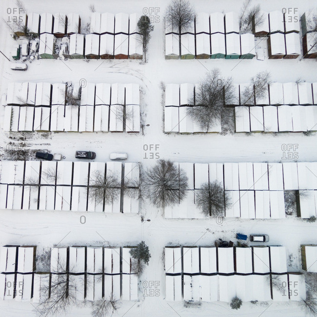 Rows of snow-covered houses in a neighborhood